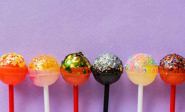 six assorted color lollipops